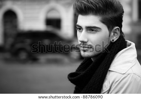 confident young man on street - stock photo