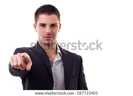 Confident young man pointing a finger at the camera - stock photo