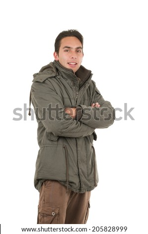 confident young man wearing green jacket posing with arms crossed isolated over white - stock photo