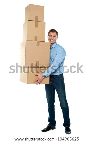 Confident young man with stack of cardboard boxes isolated against white background