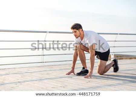 Confident young sportsman is ready to run in the morning - stock photo
