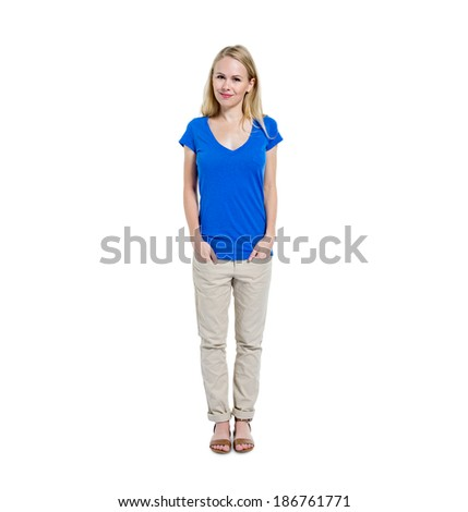 Confident Young Woman Standing and Smiling - stock photo