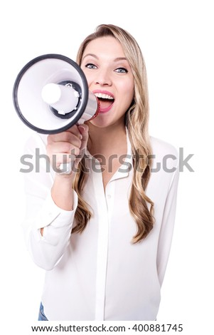 Confident young woman with a loudhailer - stock photo