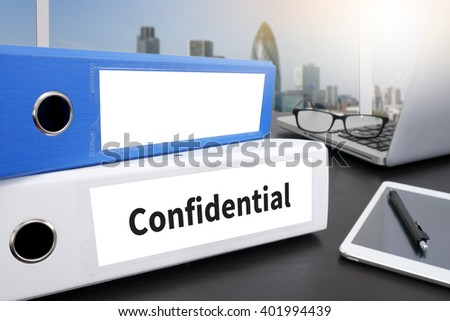 Confidential Concept  Office folder on Desktop on table with Office Supplies. - stock photo