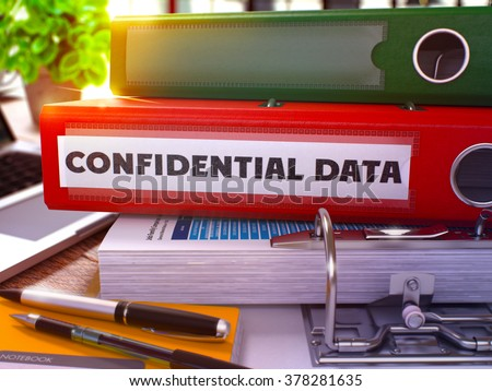 Confidential Data - Red Office Folder on Background of Working Table with Stationery and Laptop. Confidential Data Business Concept on Blurred Background. Confidential Data Toned Image. 3D. - stock photo