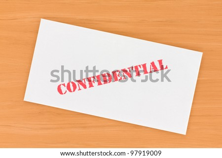 Confidential Envelope on Table - stock photo