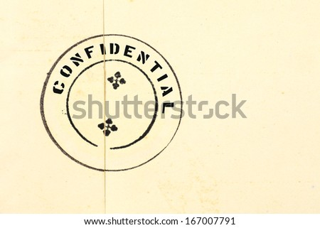 Confidential ink stamp on a grungy retro brown envelope seal.