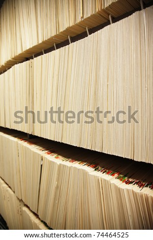 Confidential medical notes/films/data in a shelf.