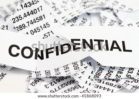 Confidential papers just shredded for security protection - stock photo