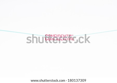 Confidential rubber stamp on envelope. - stock photo