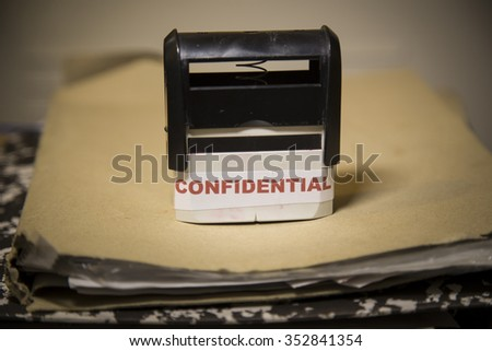 Confidential stamp sining big paper folder of top secret documents