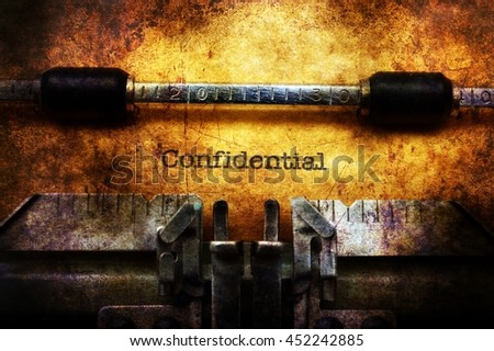 Confidential text on typewriter grunge concept - stock photo