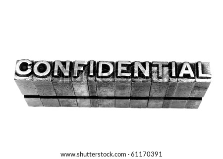 CONFIDENTIAL written in metallic letters on a white background - stock photo