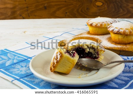 Confiture dessert on the white plate. Sweet dessert. Sweet pastry. Small pie. Pie. Jam pie - stock photo