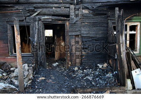 conflagration. Elements of the burned wood house - stock photo