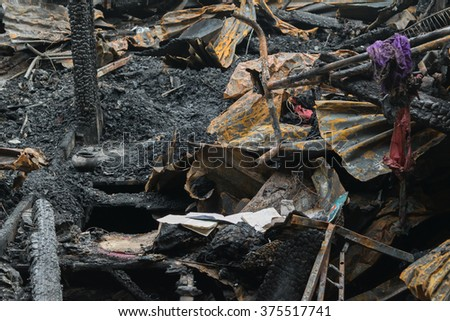 Conflagration fire damaged in summer house after blaze - stock photo