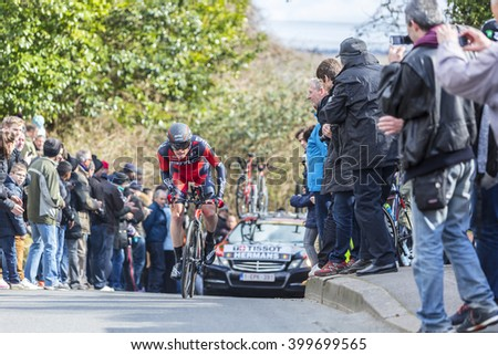 CONFLANS-SAINTE-HONORINE,FRANCE- MARCH 6: The Belgian cyclist Ben Hermans of BMC Racing Team riding during the prologue stage of Paris-Nice in Conflans-Sainte-Honorine,on March 6 2016.