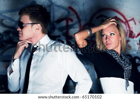 Conflict against a graffiti. - stock photo