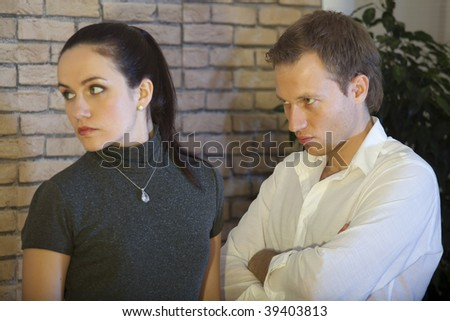 conflict between couple, unhappy woman looking away - stock photo