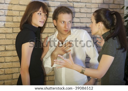 conflict between friends - angry woman speaks to the couple