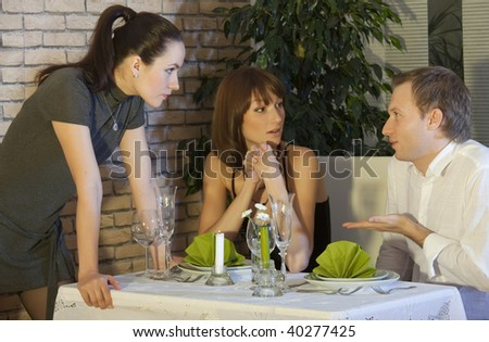 conflict between man and women in a restaurant - stock photo