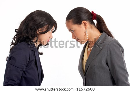 conflict between two attractive female co-workers - stock photo