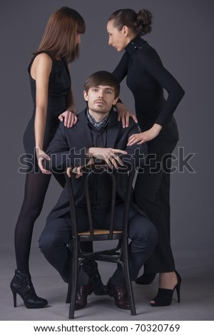 conflict between two young women over man - stock photo