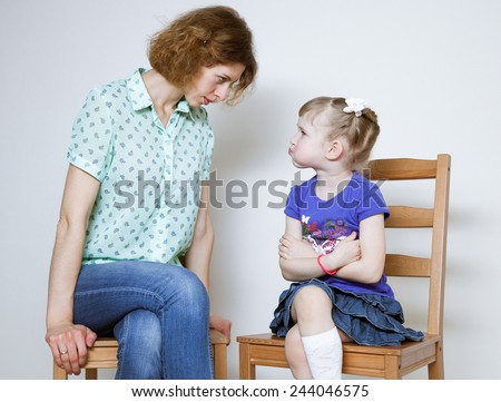 Conflict between young mother and her little daughter - stock photo
