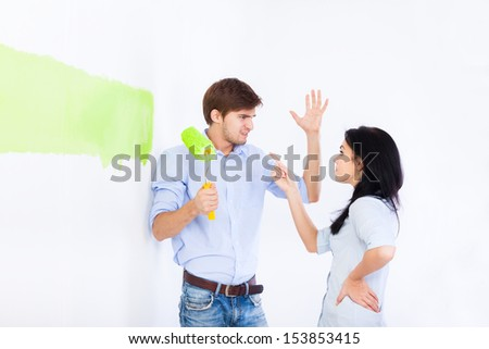 conflict couple, paint in green color white wall of their new apartment home relationship problem, negative emotion, man and woman emotional arguing
