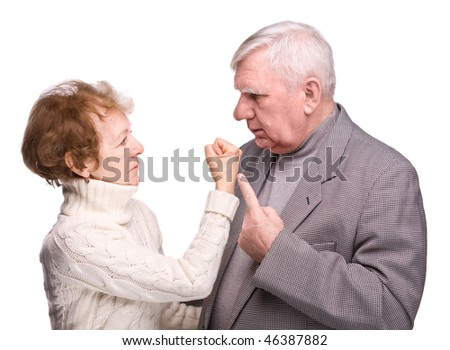 Conflict elderly couple on a white background - stock photo