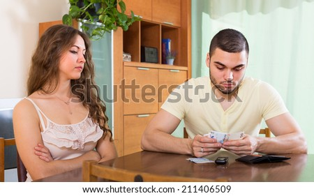 Conflict in young family due to lack of money  - stock photo
