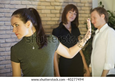 conflict scene between two women and man - stock photo