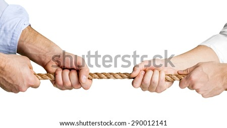 Conflict, Tug-of-war, Rope. - stock photo