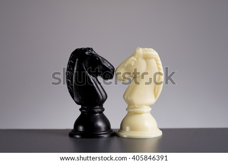 Confrontation of Black and White Horse Chess Knight on background  - stock photo