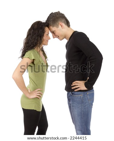 confrontation - young standing couple on the white background - stock photo