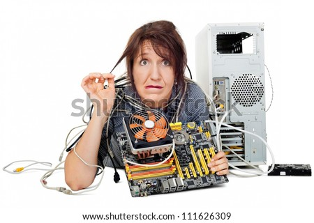 confused and grimacing woman shown computer motherboard - stock photo