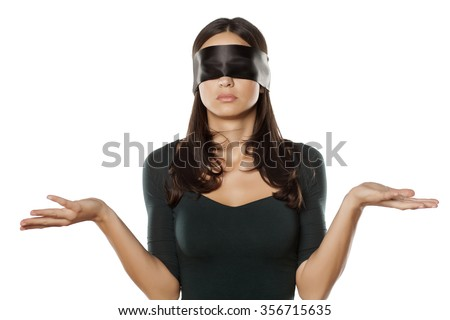 confused blindfolded woman on a white background - stock photo