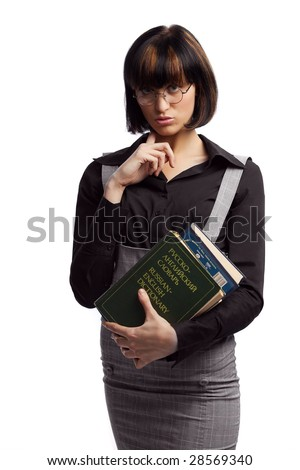 Confused brunette schoolgirl hold books in the hands over white background - stock photo