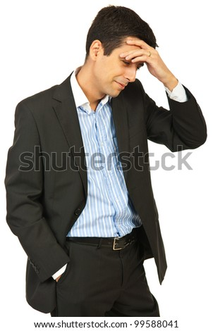 Confused business man smiling and holding hand to forehead isolated on white background