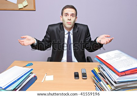 Confused businessman in an office - stock photo