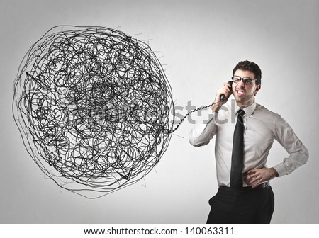 confused businessman talking on the phone - stock photo