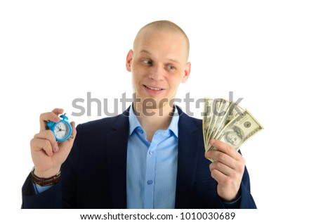 Confused Businessman with alarm clock and stack of cash in hand. Time is money concept.