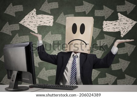 Confused businessman with paper head gesturing confuse - stock photo