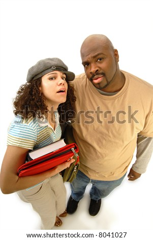 Confused college students looking up in wonder, dumbstruck and puzzled - stock photo