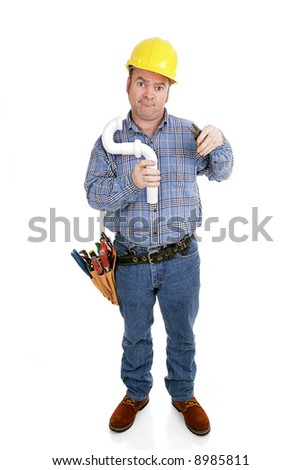 Confused construction worker using an electrical wire stripper on a plumbing pipe.  Full body isolated on white.