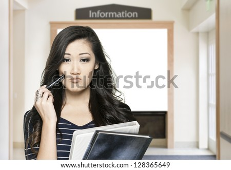 Confused female student with information window in the background - stock photo