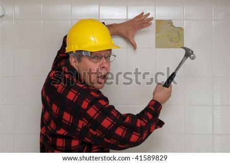 Confused handyman - stock photo