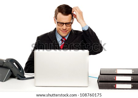 Confused male manager itching his head. Trying to understand business module - stock photo