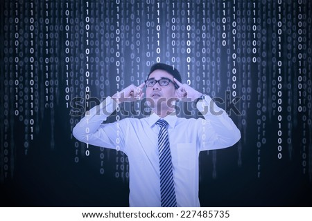 Confused man look and try to get information from binary code - stock photo