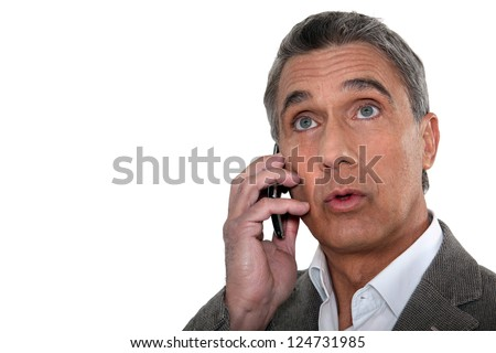 Confused man making telephone call - stock photo